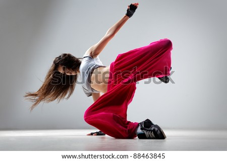 dancer posing on studio background