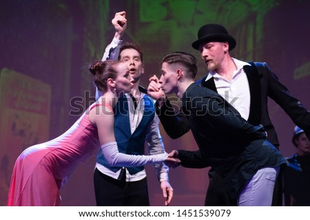 Dancers actors perform in the theater on stage in a dance show #1451539079