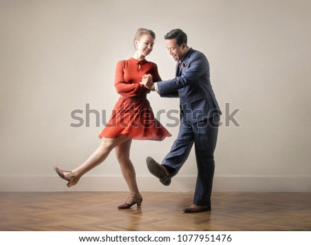 Dancers dancing together, dressing up with vintage clothes #1077951476