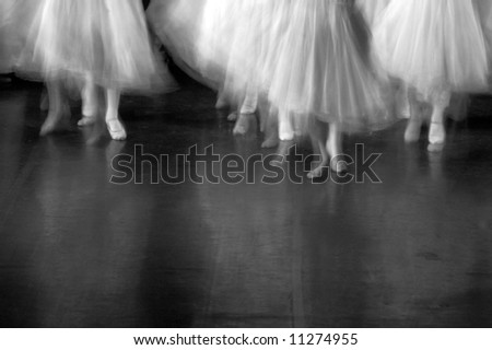 Dancers on stage during a recital. Lots of motion evident - B&W