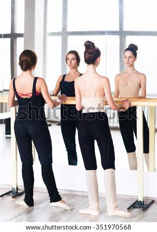 Dancers practice in studio near mirror wall #351970568