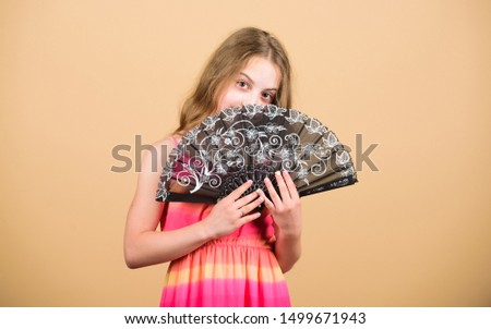 Dances with fan. Girl fanning herself with fan. Air circulation. Art and culture. Handheld fan create airflow. Airflow from handfans increases evaporation. Cooling effect. Folding fans. Acting school. #1499671943