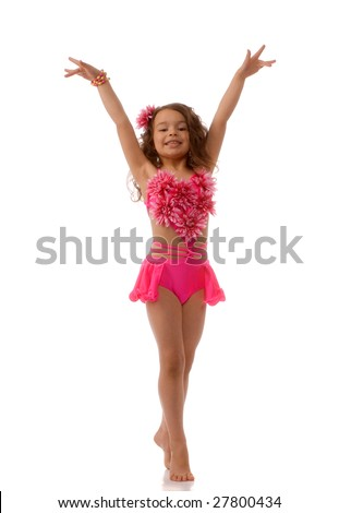 Dancing a little girl in the pink bathing suit - stock photo