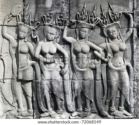 Dancing Apsaras an old Khmer art carvings on the wall in Angkor Wat temple near Siem Reap town, Cambodia - stock photo
