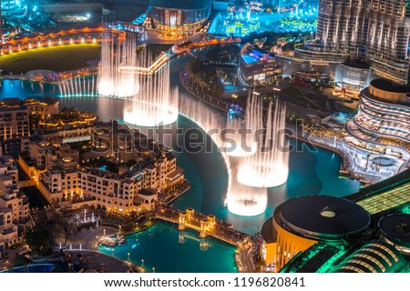 Dancing fountain show. Magical view at night. Tourist attraction. Luxury travel inspiration.
