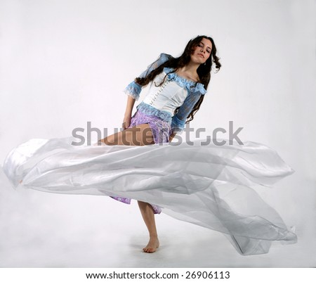 Dancing girl on a white background