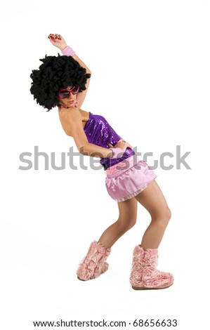 Dancing girl with sunglasses and afro-styled wig . Studio shot, isolated on white background