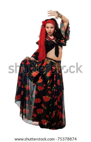 Dancing gypsy woman in a black skirt. Isolated