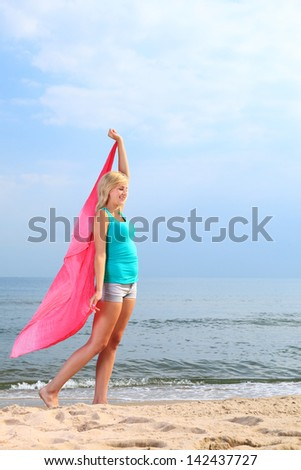 dancing happy girl on the beach woman vacation, summertime fun concept