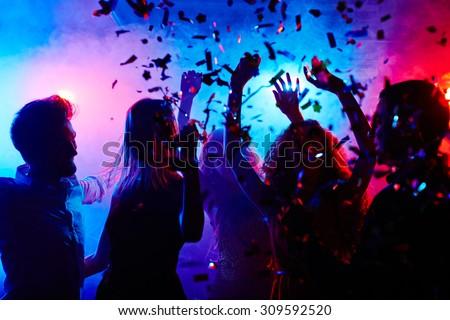 Dancing people at nightclub on Halloween night