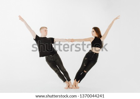 Dancing Pose of Professional Caucasian Performer. Caucasian Woman, Man Dancer in Black Denim and Top. Dancer Partner Hold Hand. Contemporary Couple in Allonge Position Isolated on White Background #1370044241