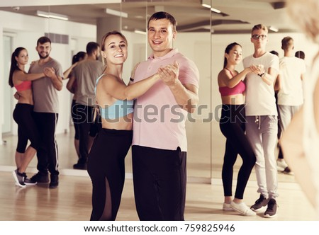 Dancing positive british  couples learning salsa at dance class #759825946