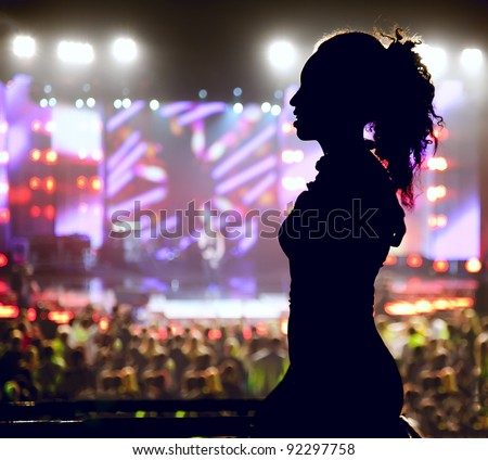 Dancing silhouette of woman in a nightclub