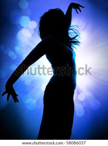dancing silhouettes of woman in a nightclub