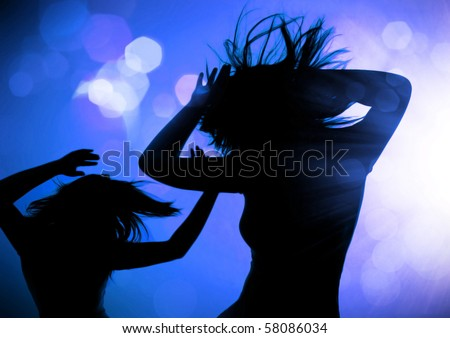 dancing silhouettes of women in a nightclub