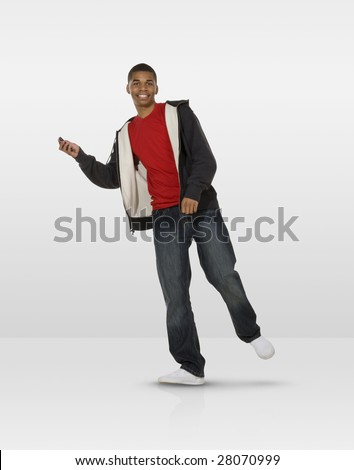 Dancing teen with mobile phone