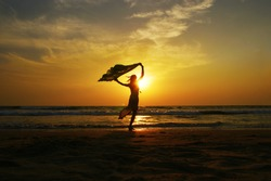 Dancing woman on the beach in Florida.sunset on the beach of Florida