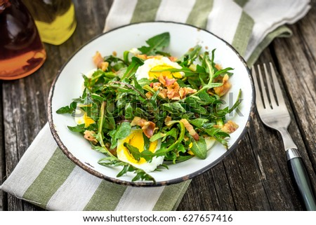 Dandelion salad with eggs and bacon #627657416