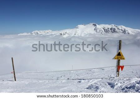 Danger avalanche sign in Alpe du Grand Serre ski resort, Isere, Alps, France, near Grenoble.