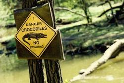 Danger crocodiles, no swimming - caution in nature.