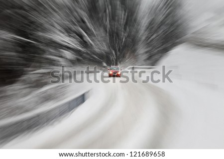 Danger driving at the heavy snow road. Motion zoom visualizies the speed and dynamics.