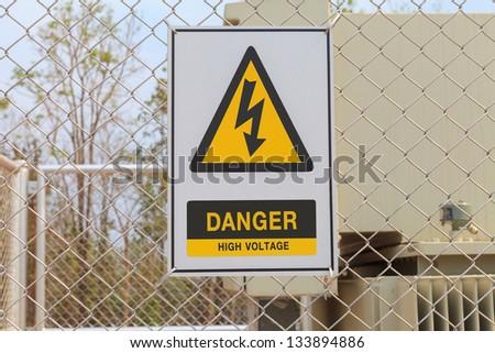 Danger High Voltage sign on a fence