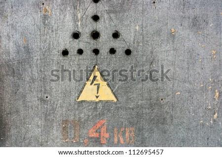 Danger, high voltage sign on steel background