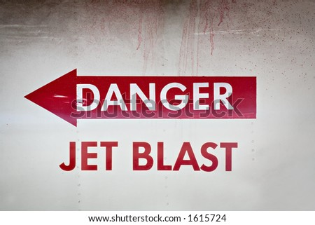 danger jet blast warning on the side of a jet fighter