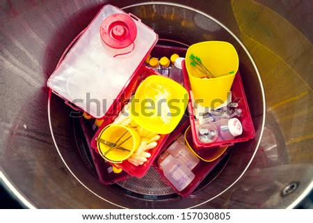 Danger medical waste disposed in a garbage box