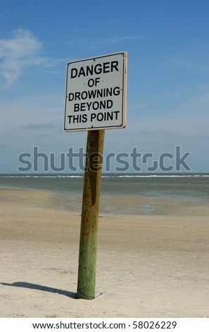 Danger of drowing warning sign on beach