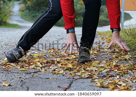 Danger of slipping in autumn and winter. A woman slipped on wet, smooth leaves Сток-фото ©