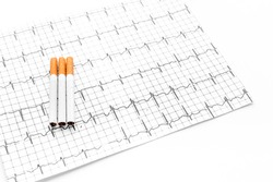 Danger of smoking. Cigarettes on cardiogram on white background