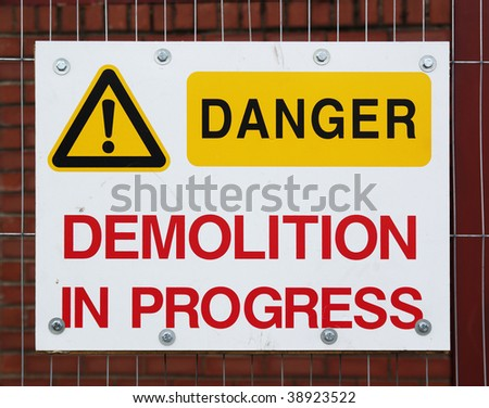 Danger sign on a construction fence