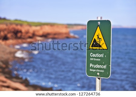 Danger sign on eroding cliffs of the National Park on the north shores of Prince Edward Island, Canada.