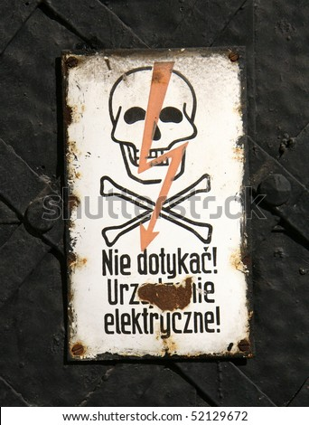 "Danger sign - with the polish inscription ""Don't touch! Electric appliance!"""