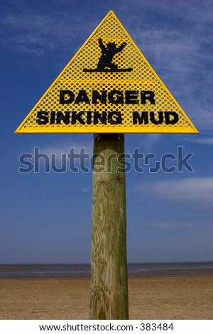 Danger sinking mud sign, sand point beach England uk