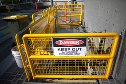 Danger tag sign keep out authorised personnel only in the isolated exclusion zone fence on construction building site Perth city down town, Australia