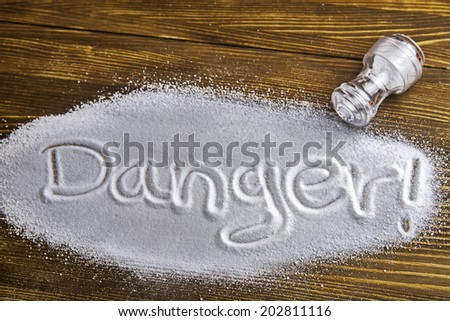 DANGER written on a heap of salt - Health Hazard