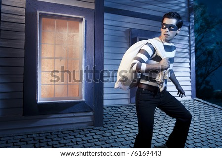 dangerous burglar about to enter house