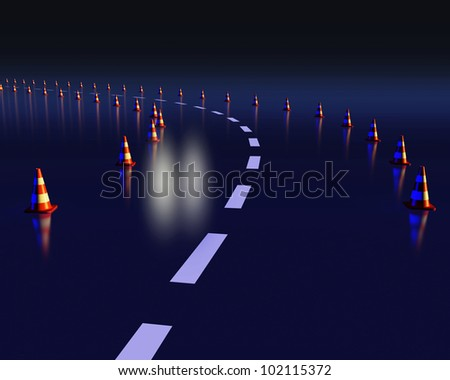 Dangerous curve at night with cones and headlights