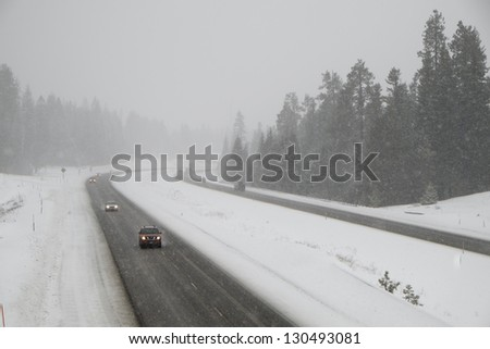 Dangerous driving on snow-covered interstate highway in winter