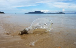 dangerous garbage on the seashore. lamp from a ship thrown to the seashore. high-pressure discharge lamp used on fishing vessels