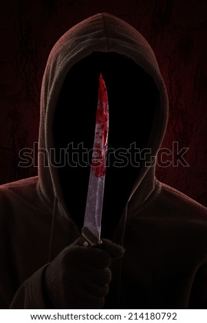 Dangerous Hooded Man Standing In The Dark And Holding A ...