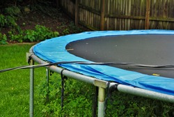 Dangerous live downed power line draped across trampoline