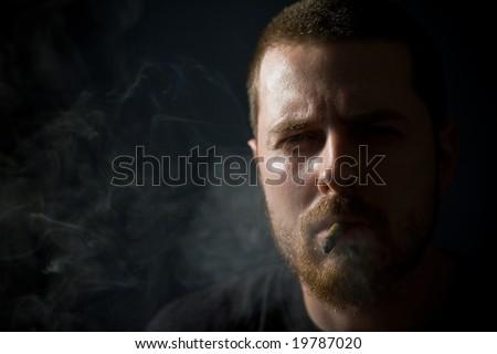 Dangerous looking guy smoking a cigar