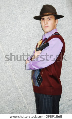 Dangerous looking mafia type with revolver.