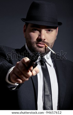 Dangerous man in suit with a gun