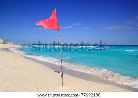 dangerous red flag in beach with rough sea signal