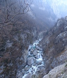 Dangerous river in the Rugova Canyon in the Balkans of Kosovo in a foggy cold day