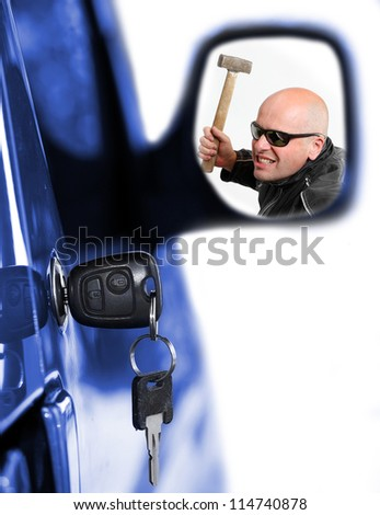 Dangerous thief in rear mirror and key at car doors. Car insurance concept.